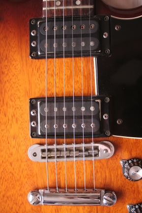 Black paint scratched away from the pickup covers, but much less extreme than on most SFs